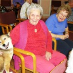 Shiba Inu smiles with woman who had owned Scottish Terriers