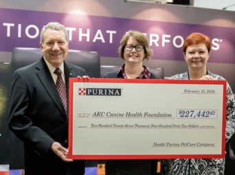 Dr. J. Charles Garvin, CHF Board President, Dr. Diane Brown, CHF CEO, and Ann Viklund, Purina Director of Conformation