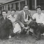 At the Puli Club of America National Specialty judged by Alva Rosenberg on September 21, 1957, Alva awarded Best of Breed to Ch. Cedwood's Anthony Gray, handled by Joyce McComiskey (left) for owner Mrs. Elleanor Anderson (second from left): and Best of Opposite Sex to Mrs. John McManus (right) for her owner-handled bitch, Cedwood's Katalin.